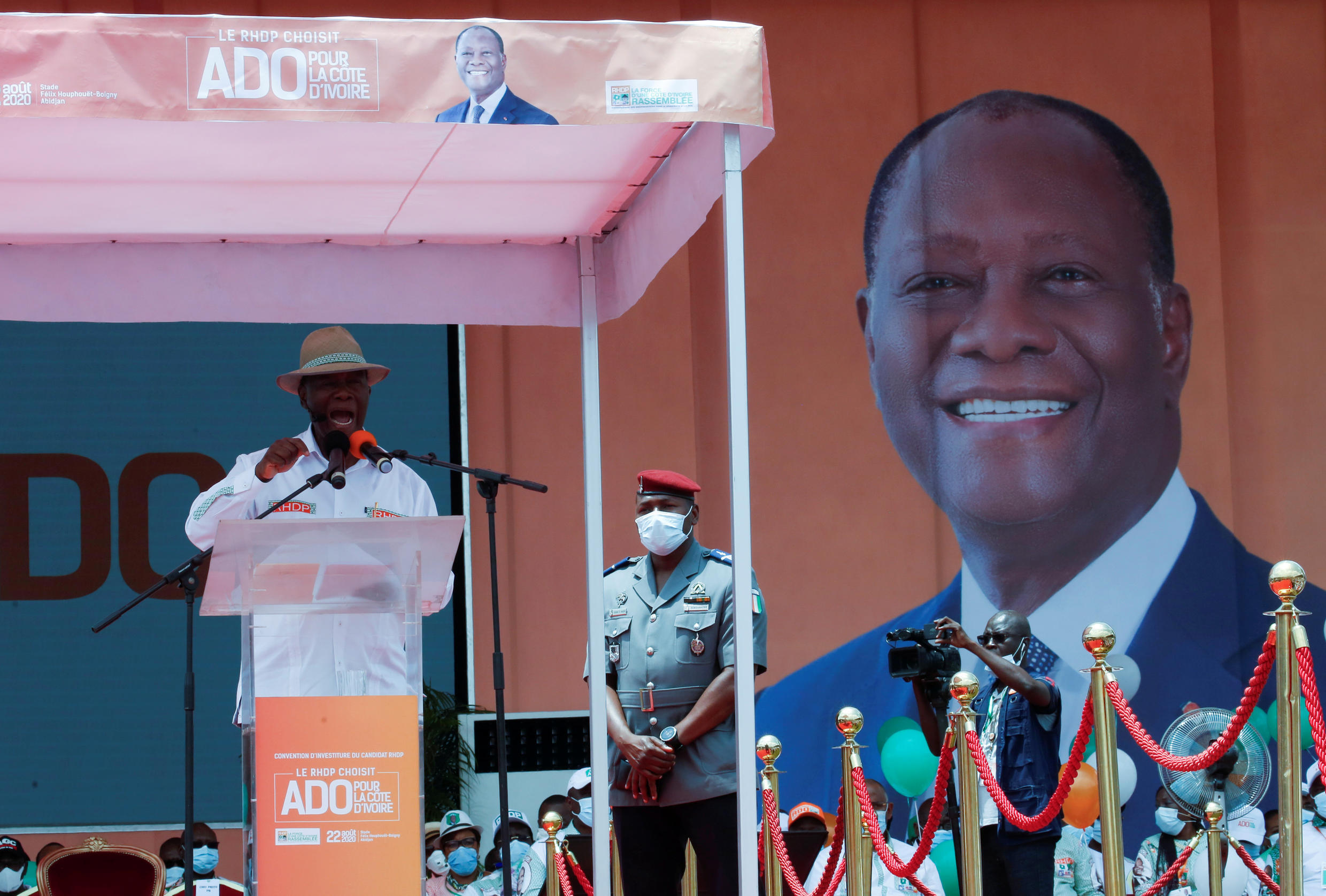 President Alassane Ouattara speaks at the meeting of the ruling coalition party organised to nominate him to stand for a third term in October's election in Abidjan, August 22, 2020.
