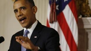 O presidente dos EUA, Barack Obama, faz comentários sobre o fim do shutdown em uma sala da Casa Branca, em Washington, neste 17 de outubro de 2013.