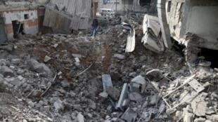 Wani yanki na gabashin Ghouta, da barin wutar jiragen yaki ya ragargaza.