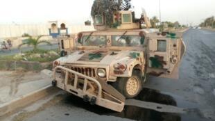 Xe quân sự của lực lượng an ninh Irak bỏ lại tại Tikrit, nơi mà l'EIIL đã kiểm soát.