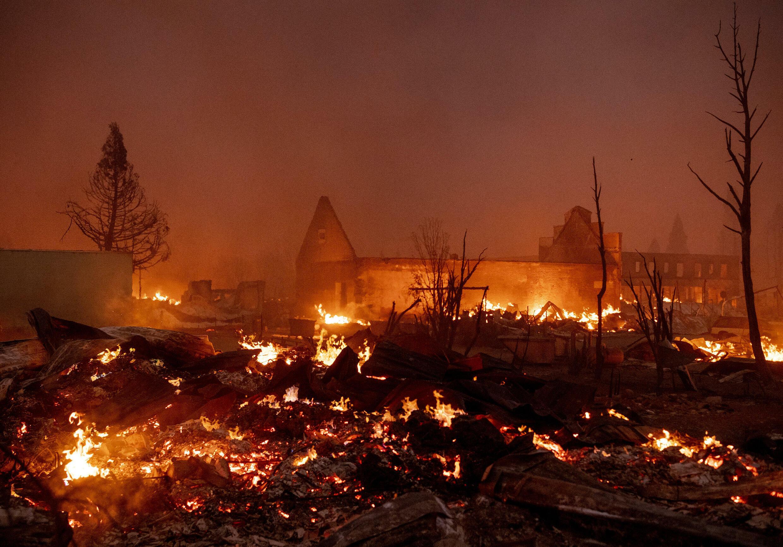 Buildings burn as the Dixie Fire tears through downtown Greenville, California on August 4, 2021
