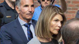 Actress Lori Loughlin and husband Mossimo Giannulli, shown here in August 2019, switched their previous pleas of innocence to guilty in a bid to lighten their sentences for conspiracy to commit fraud