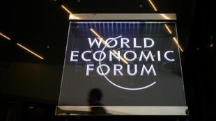 A man walks past a sign of the World Economic Forum (WEF) at the Congress Centre in Davos, eastern Switzerland
