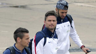Mathieu Debuchy, Olivier Giroud and Karim Benzema upon arriving back in France. 6 July 2014.