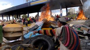 Demonstrators burn a tollbooth at an entrance to El Alto, in La Paz