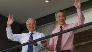 Thủ tướng Singapore Lý Hiển Long (phải) và người đồng nhiệm Malaysia Najib Razak, Singapore, 19/02/2013.
