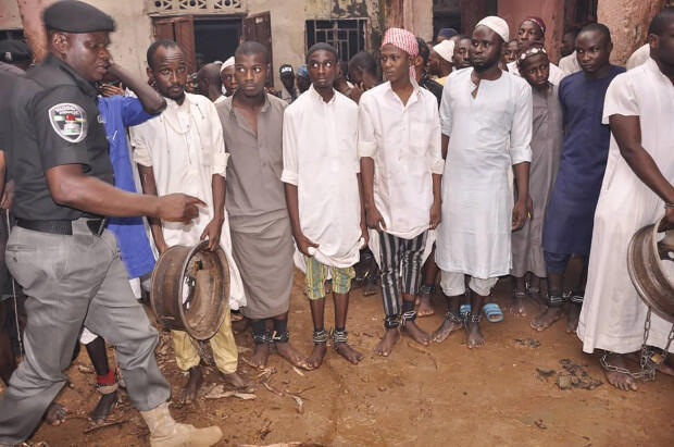 Nigerian police free hundreds of modern day slaves chained up during raids at junk Koranic schools