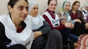 Feleknaz Uca (L) with some of the prisoners' families on hunger strike at HDP headquarters in Diyarbakir, Turkey.