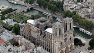 An aerial view of the roof of Notre-Dame Cathedral that was ravaged by an accidental fire, 14 July 2019.