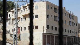 L'immeuble Rajabi, à Hébron en territoire palestinien, a été racheté par des colons à un Palestinien dans des conditions troubles. Mais la justice leur a donné raison. Photo prise en novembre 2013.