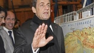 Nicolas Sarkozy visits a small firm, as part of his electoral campaign in Nice, southern France