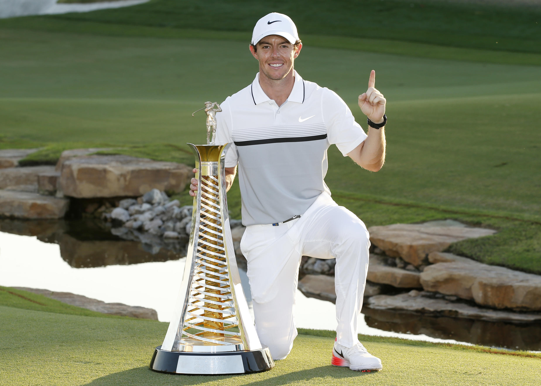 Rory McIlroy celebrates after winning the Race to Dubai championship in Dubai on Sunday.