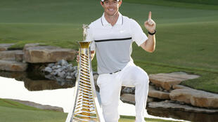 Rory McIlroy celebrates after winning the Race to Dubai championship in Dubai on Sunday.