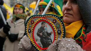 A demonstrator holds a portrait of Ocalan in Strasbourg on Saturday