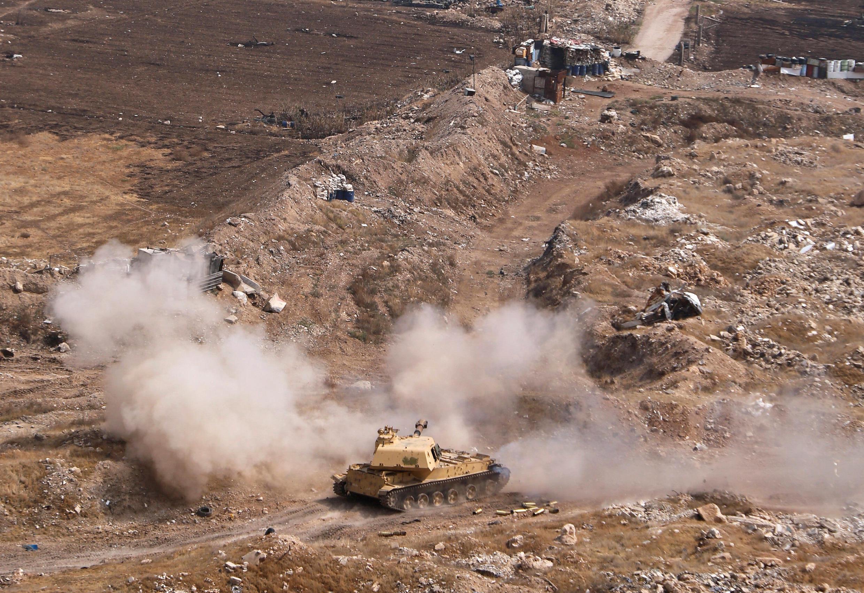 Un tank au milieu d'un camp de ruines: le camp palestinien de Yarmouk, banlieue sud de Damas, le 28 avril 2018.