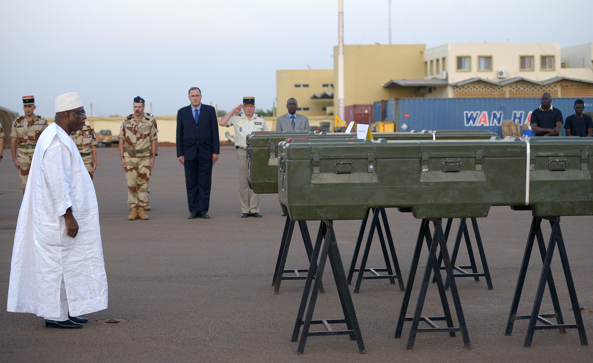 Malian President Ibrahim Boubakar Keita pays homage to the coffins of Ghislaine Dupont and Claude Verlon before they are sent to France