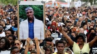 The portrait of Adama Traoré is brandished during a demonstration in Beaumont-sur-Oise, July 21, 2018.
