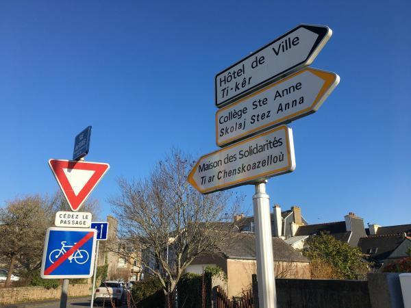 Public signs around Brittany display both French and Breton languages. The number of Breton speakers fell from a million in 1950 to about 200,000 today, and many in the region are working to revive it, to maintain its status and to teach it in schools.