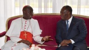 Le cardinal Jean Pierre Kutwa, archevêque d'Abidjan lors d'une rencontre avec le président Alassane Ouattara. Le 14 juillet 2017 à Abidjan.