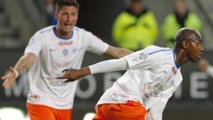 'Yan wasan Montpellier  Olivier Giroud da Souleymane Camara.