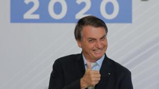 O presidente Jair Bolsonaro sorri durante um ato celebrado em 9 de dezembro de 2020 em Brasilia.