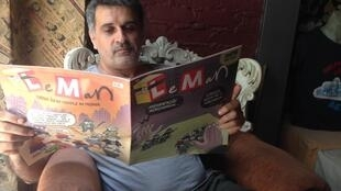 Leman director Zafer Aknar reads the edition whose cover led to seizure by police.