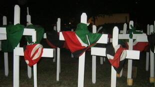 Crosses adorned with Kenyan flags in tribute to Garissa University massacre