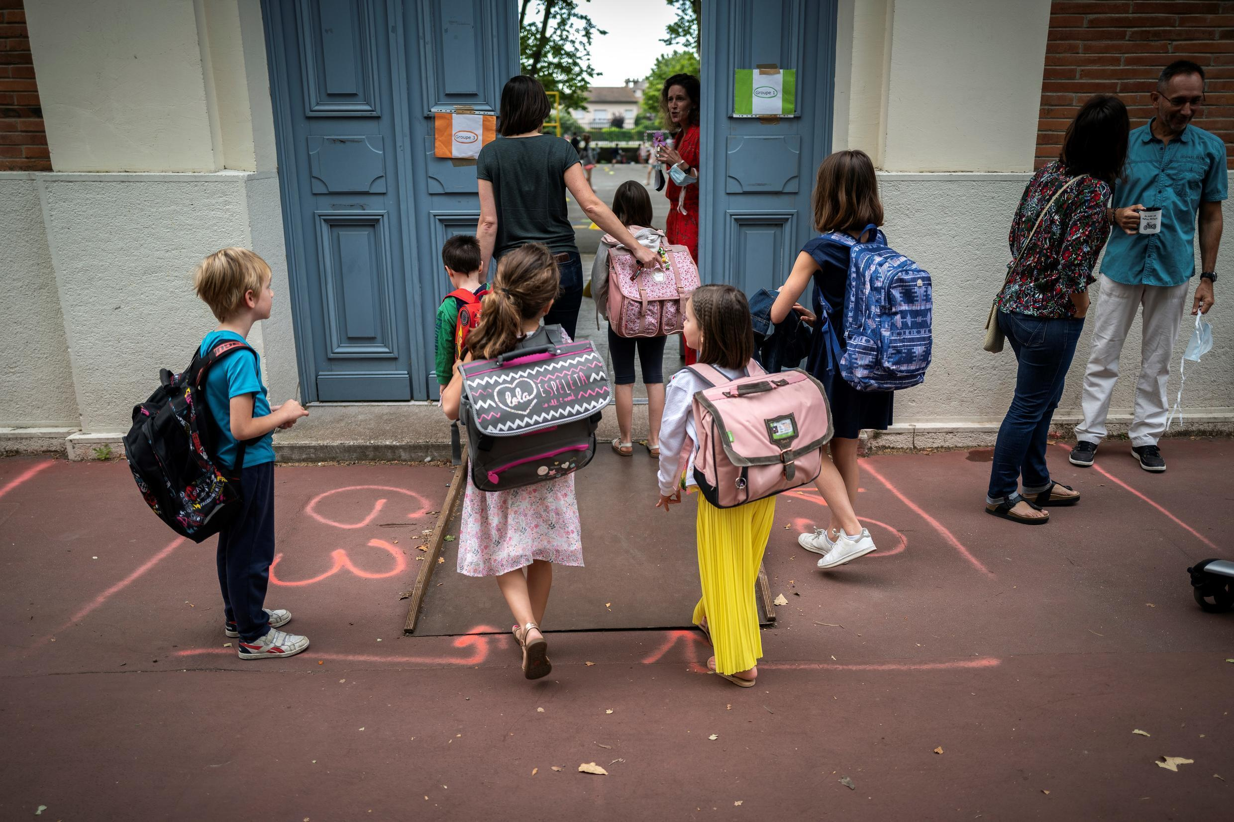 Many teachers and parents are worried the reopening of schools will accelerate the spread of Covid-19, but governments have insisted it should go ahead