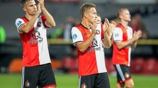 Robin van Persie (L) and his Feyenoord teammates applaud to their supporters after a draw in their UEFA Europa League qualifying match.