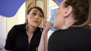Lilit Martirosyan, 28, a transgender woman, applies make-up during an interview in Yerevan on May 6, 2019.