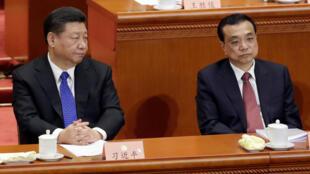 图为中国主席习近平与总理李克强2018年3月3日出席第13届全国政协开幕式