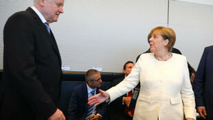 La canciller Angela Merkel y el ministro del Interior, Horst Seehofer, el 3 de julio de 2018.