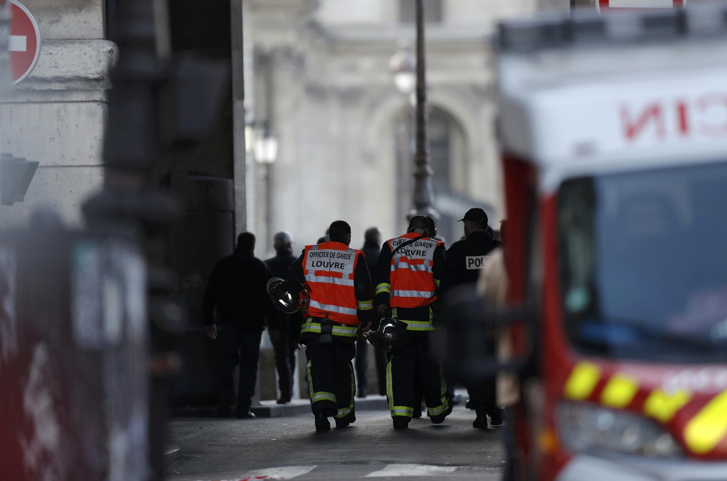 French firefighters and police are seen at the site near the Louvre Pyramid in Paris French firefighters and police are seen at the site near the Louvre Pyramid in Paris, France, February 3, 2017.