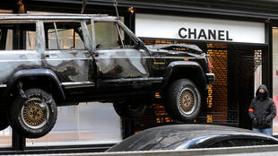The vehicle used to ram the Chanel shop is moved