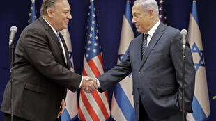 US Secretary of State Mike Pompeo (L) is due to visit Israel in a show of support for a new coalition government agreed between Prime Minister Benjamin Netanyahu (R) and his rival Benny Gantz