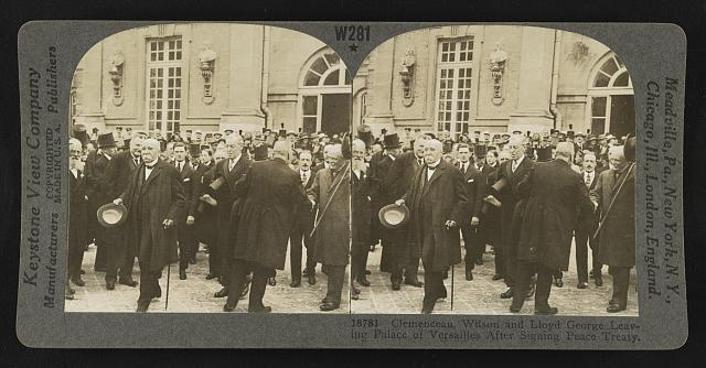 clemenceau wilson and lloyd george leaving palace of versailles after signing peace treaty