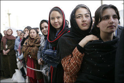 Women of Afghanistan stand outside the U.S. Embassy in Kabul, Wednesday, March 1, 2006.