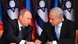 Rais wa Urusi Vladimir Putin akiwa na waziri mkuu wa Israel Benjamin Netanyahu