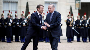 French President Emmanuel Macron with Turkey's Recep Tayyip Erdogan at the Elysée on 5 January