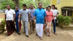 Sri Lanka's former President Mahinda Rajapaksa (3rd R) arrives at a polling station during the general election in Medamulana August 17, 2015.