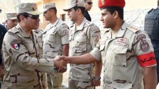 Shugaban kasar Masar Abdul-Fatah al Sisi a lokacin da ya ziyarci yankin Sinai