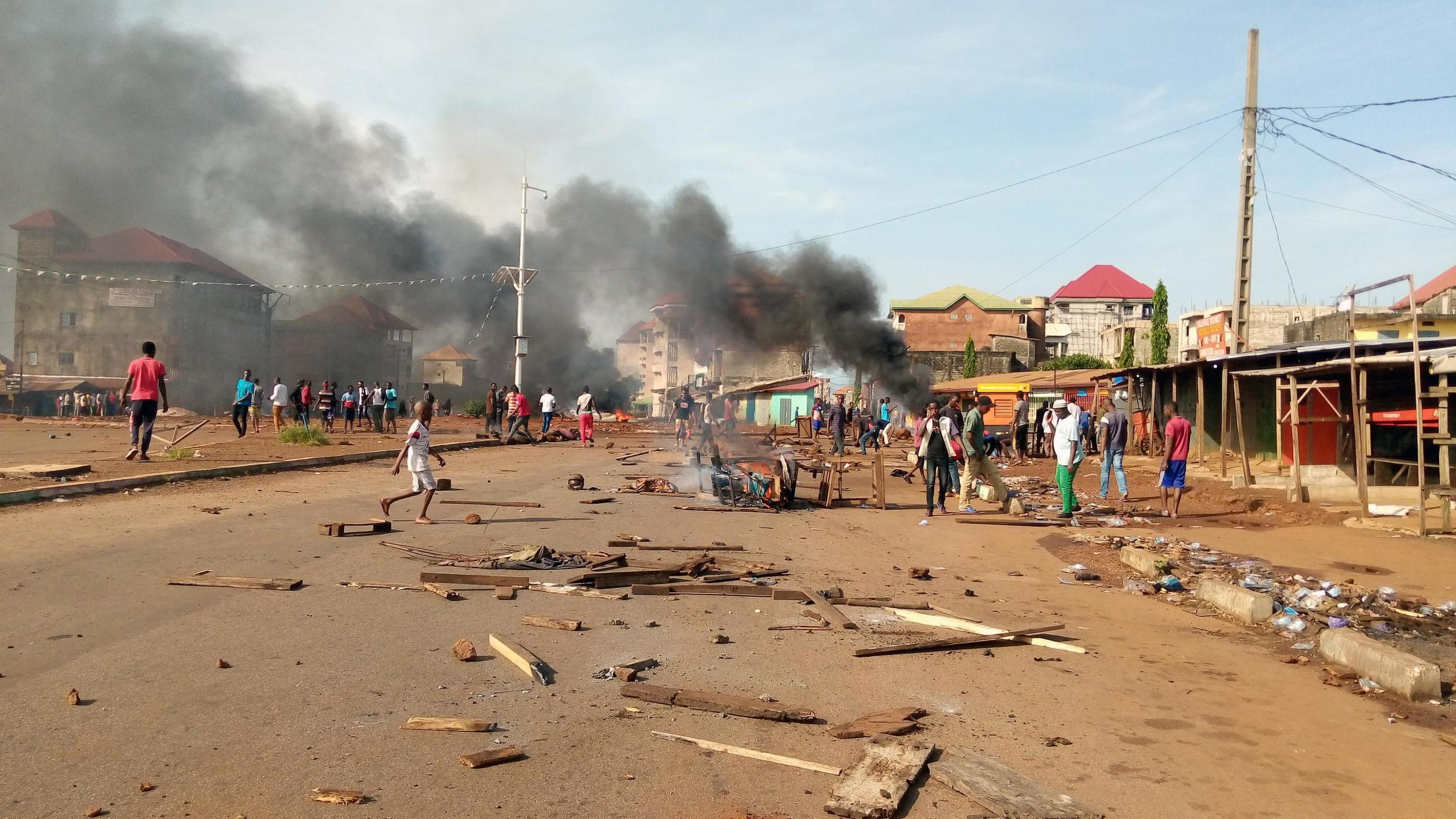 On the streets of Conakry, Guinea, on Wednesday, violence flared as the votes were tallied.