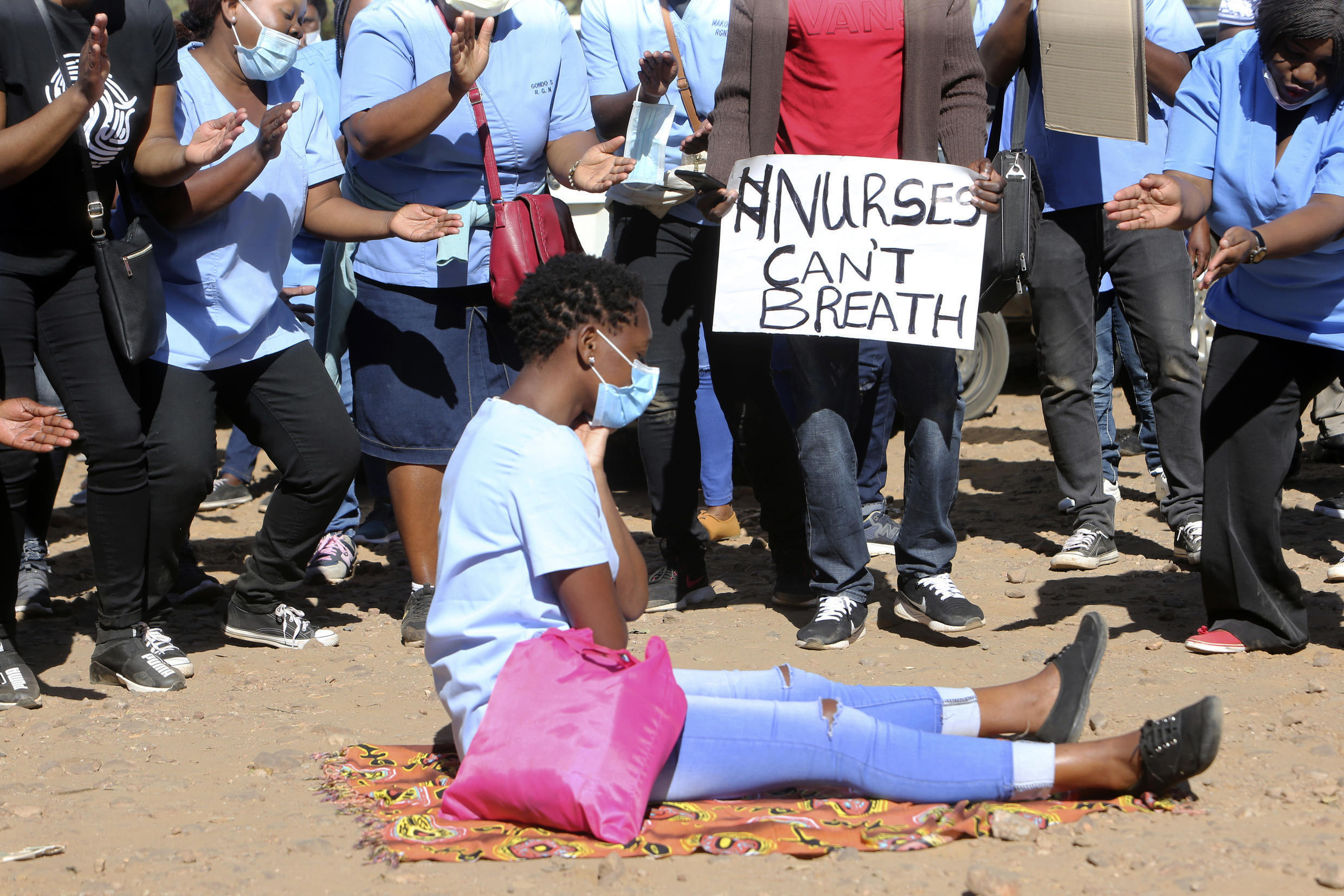 Nurses taking part in a protest at a Harare, Zimbabwe hospital, Monday, July, 6, 2020. Thousands of nurses working in public hospitals stopped reporting for work in mid-June, as health workers earn less than US$50 a month