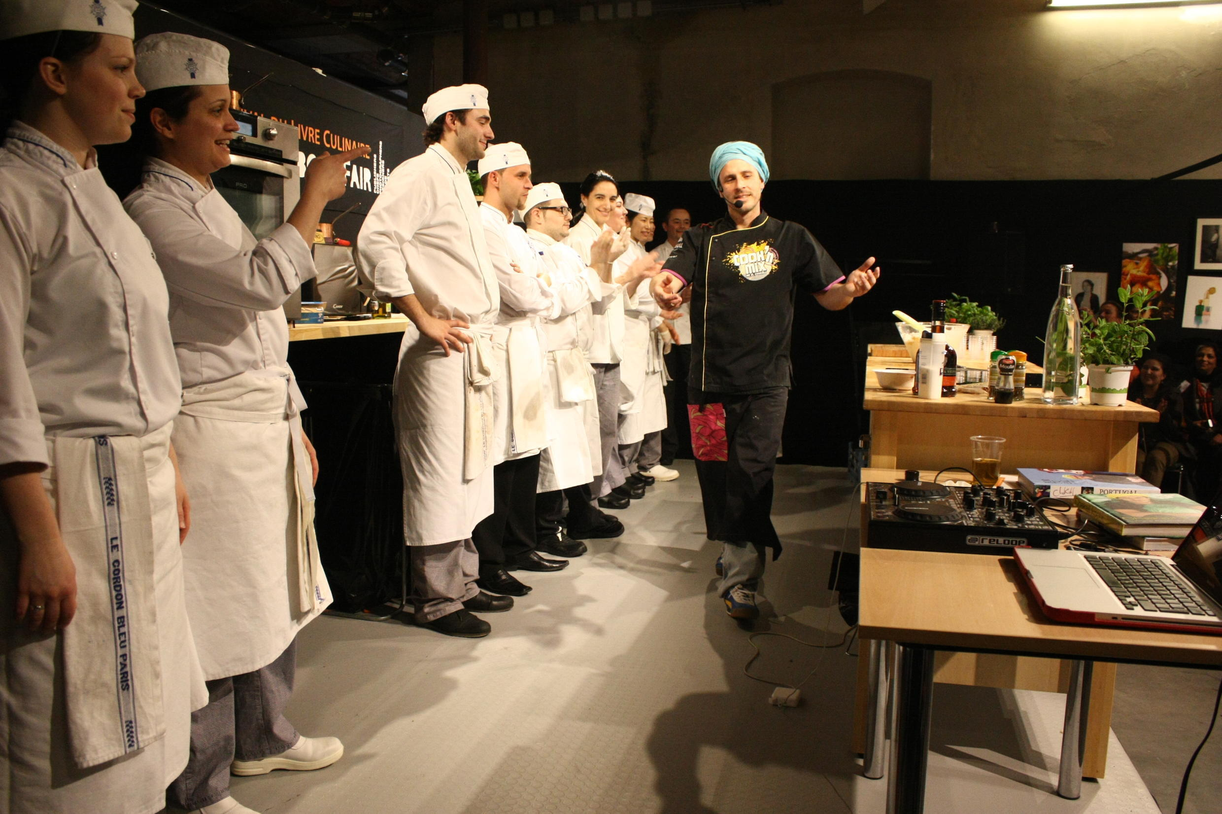 A chef gives a demonstration at the cookbook festival in Paris