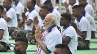 Indian Prime Minister Narendra Modi performs yoga on International Yoga Day in Ranchi, India, 21 June 2019.