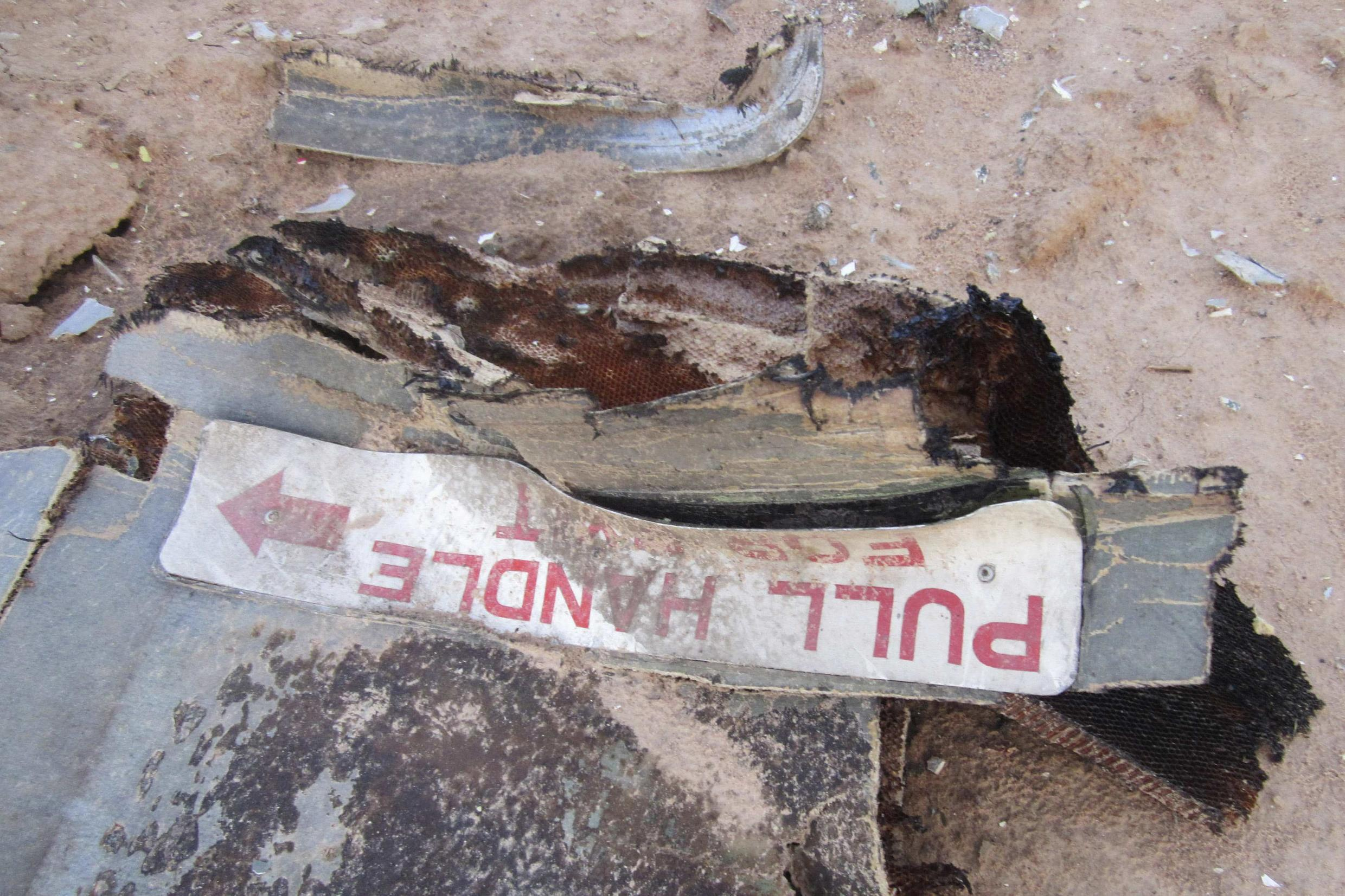 Debris from the crashed Air Algérie plane at the site of the accident in Mali