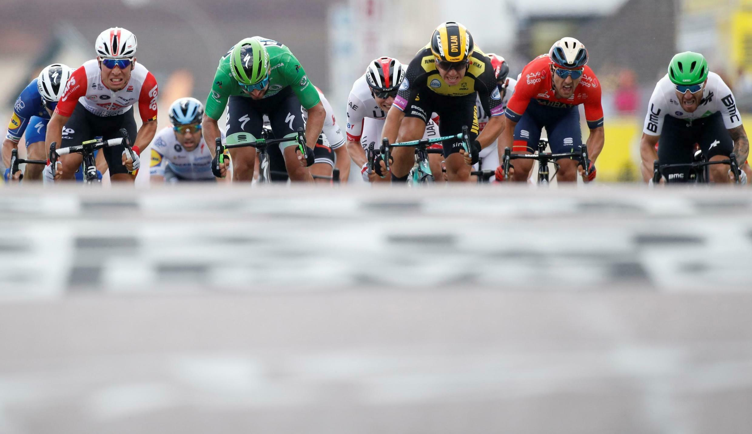 Dylan Groenewegen (yellow) of the Netherlands, Caleb Ewan of Australia, Peter Sagan of Slovakia, and Sonny Colbrelli of Italy sprint towards the finish line of the 230-km stage 7, 12 July 2019.