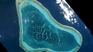 Chinese ships crowd around the disputed Scarborough Shoal in the South China Sea in satellite images taken on 12 March 2016.