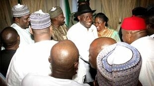 Nigerian President Goodluck Jonathan (C) is greeted by supporters after being declared winner
