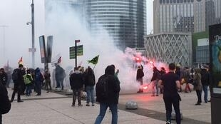 Railworkers protest outside the head quarters of  SNCF-Voyages in the Paris business district of La Defense, Juin 12